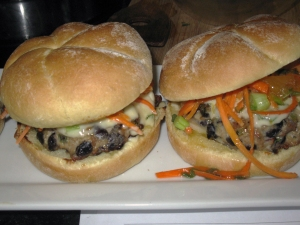 jerk spiced pork'n bean burger with island mayo 'n caribbean carrot slaw